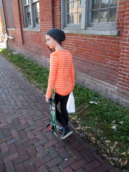 My daughter with her $12 skateboard-artifact