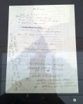 """Handwritten lyrics for """"Head Case"""". One wants to know who Heidi is, and the story there behind the lyrics. It's difficult to determine what was printed on the opposite side of the page, but it's clear that Joey Ramone was writing on whatever was to hand."""